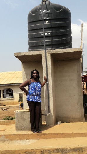 , Janet constructed four public water stands and employs local women to run them.